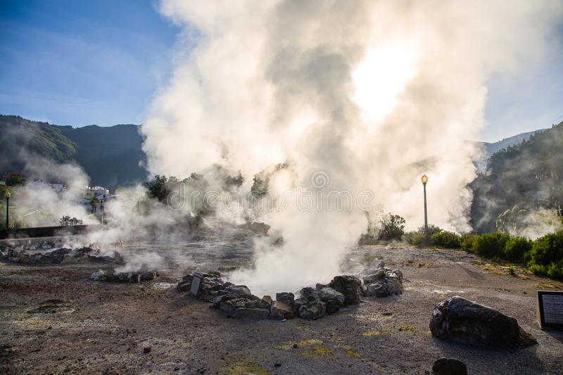 Volcanic eruption of hot steam in Furnas, Sao Miguel island, Azores archipelago. Volcanic eruption of hot steam in the town Furnas, Sao Miguel island, Azores stock images