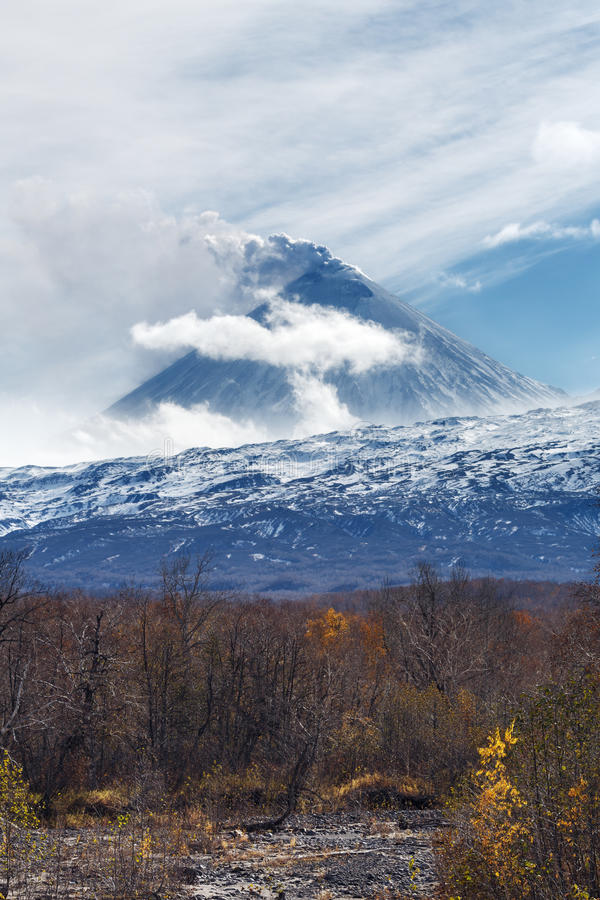 Volcanic eruption: plume of gas, steam, ash from crater. Volcanic landscape of Kamchatka: active Klyuchevskaya Sopka, view of volcanic eruption - plume of gas royalty free stock images