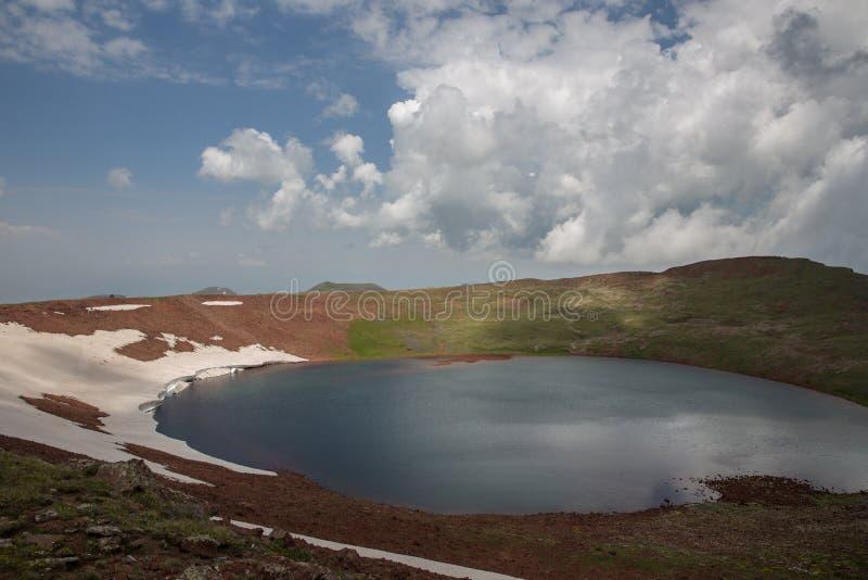 Lake At the mountains volcanic Lake. Volcanic Lake at the mountains Armenia Armenian mountains Ararat Mountains Geghama Mountains stock photo