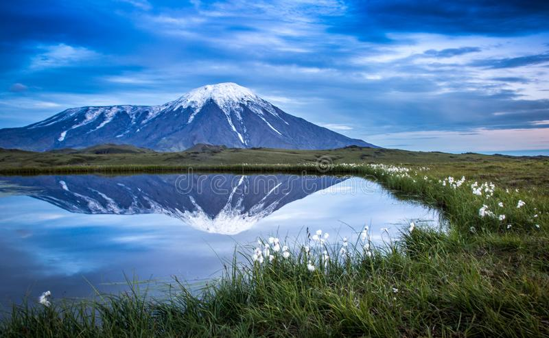 Volcanic land near Tolbachik views of sunrise reflection off a pond n stock photography