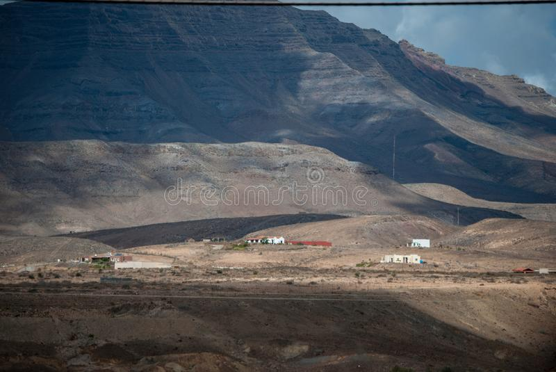 Fuerteventura, farm under volcano. stock images