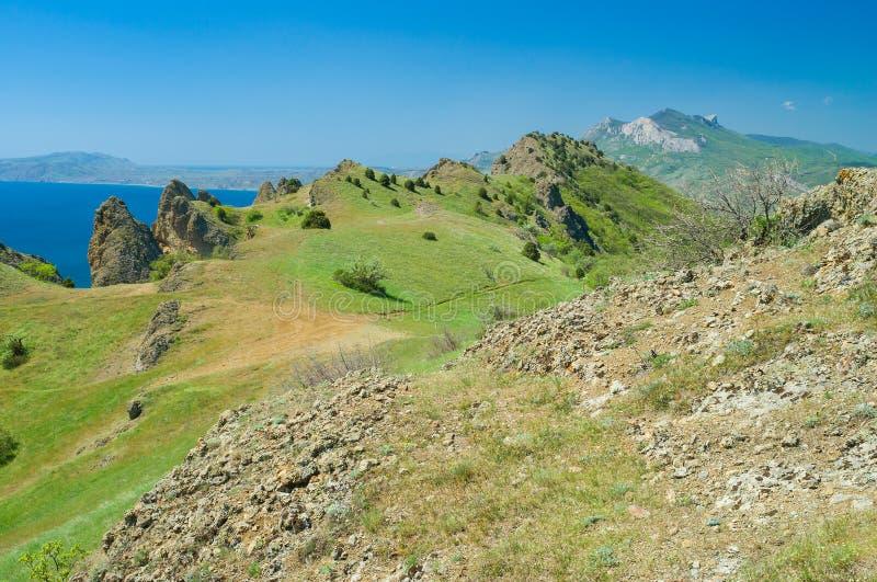 Volcanic mountain range Kara Dag at spring season stock images