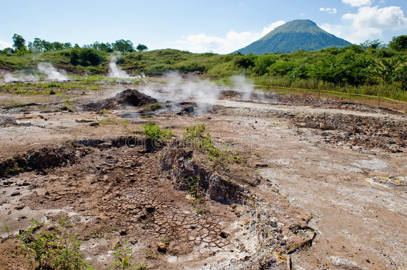 Volcanic mud pots. In countryside with volcano in background, Nicaragua royalty free stock photography