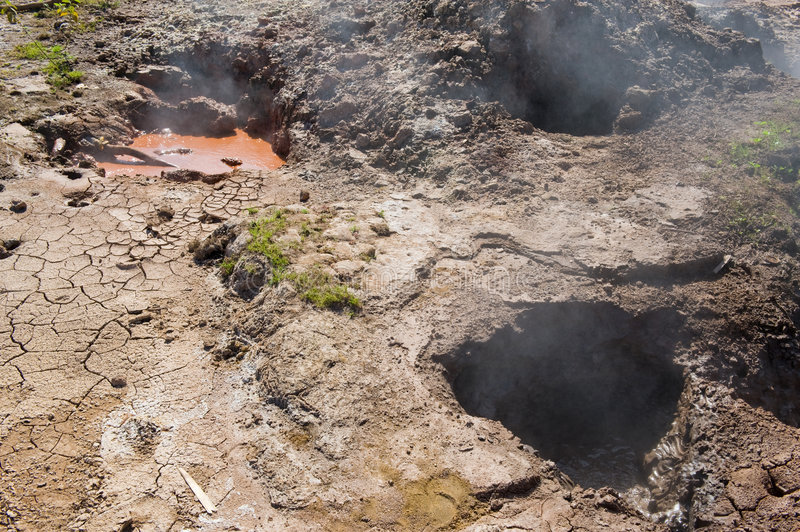 Volcanic mud pots. Close up of steaming volcanic mud pots stock photography
