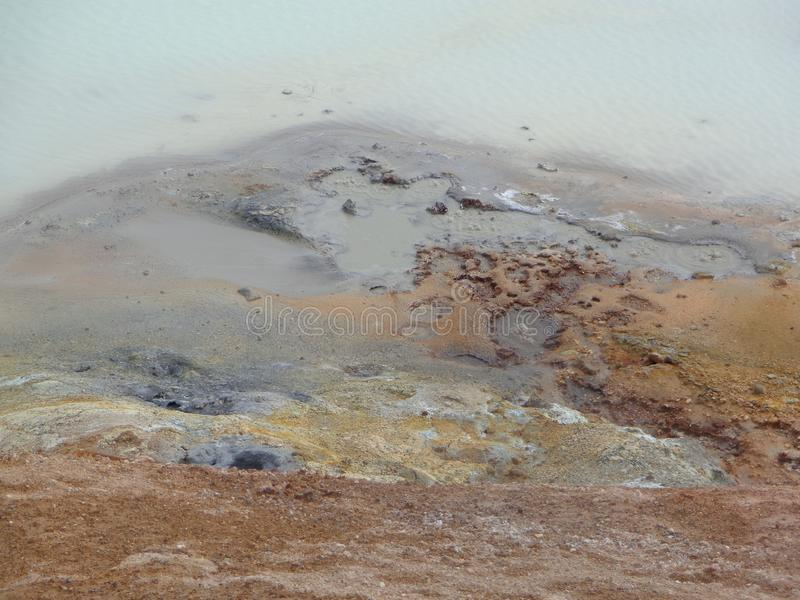 Volcanic mud puddle. Colourful, sulphate, ferric, smoky, smell royalty free stock images