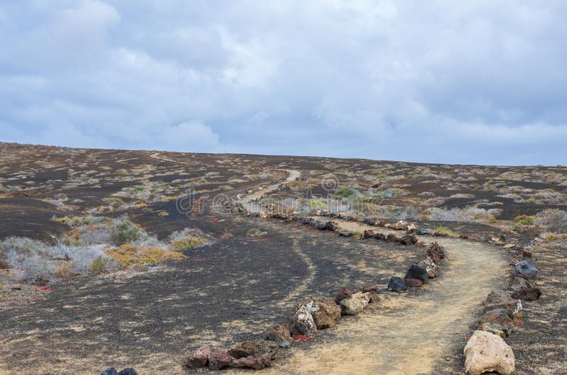 Volcanic path made by rocks royalty free stock photo