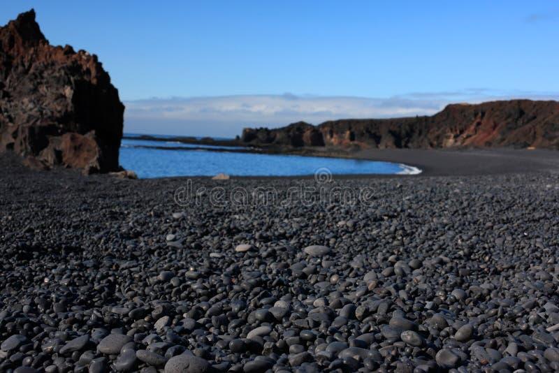 Volcanic pebble beach stock photo