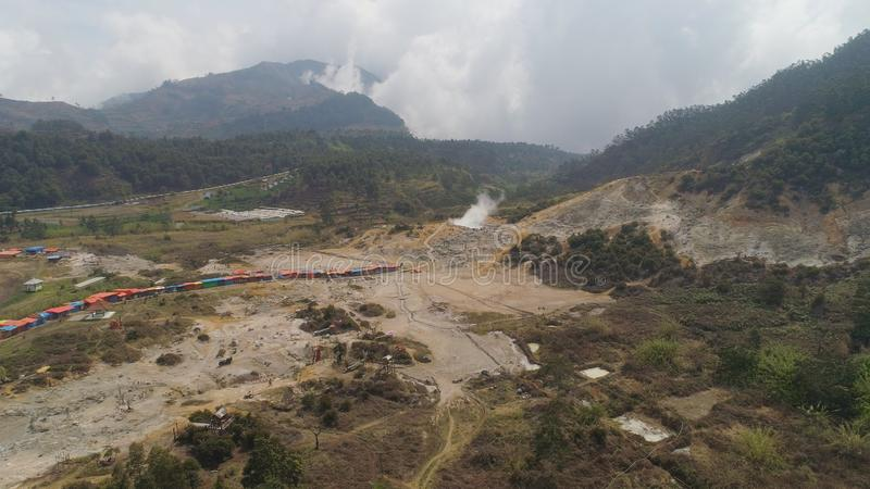 Volcanic plateau Indonesia Dieng Plateau. Plateau with volcanic activity, mud volcano Kawah Sikidang, geothermal activity and geysers. aerial view volcanic stock photography