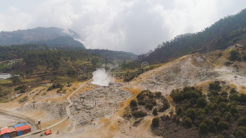 Volcanic plateau Indonesia Dieng Plateau. Plateau with volcanic activity, mud volcano Kawah Sikidang, geothermal activity and geysers. aerial view volcanic royalty free stock photography