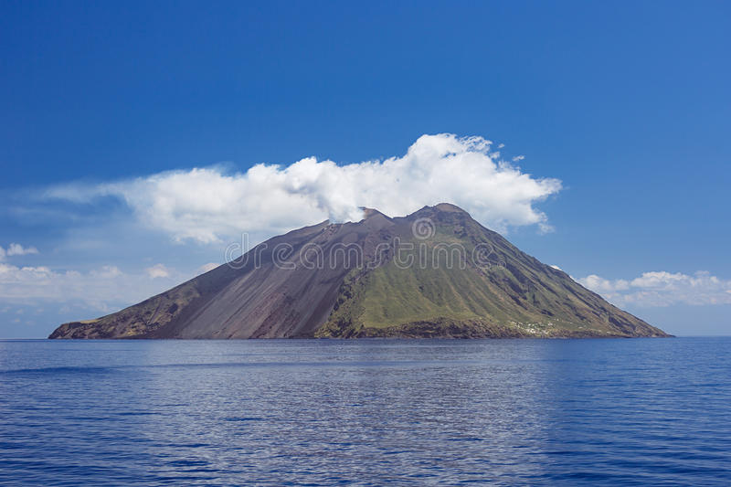 Volcanic plume and clouds above Stromboli Island. The volcano has erupted many times and is constantly active with minor eruptions. Mt. Stromboli has been in royalty free stock images