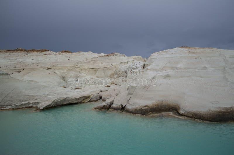 Volcanic Rock Cliffs at Sarakiniko Beach in Milos, Cyclades, Greece stock photo