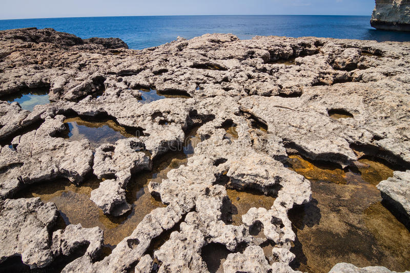 Volcanic rock coast in the Azure Window. Volcanic cliffs at Azure Window on the Maltese island of Gozo royalty free stock photography