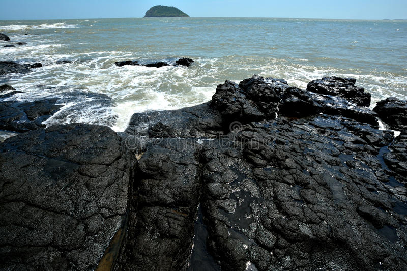 Download Volcanic rock by sea stock photo. Image of water, wide - 33803538