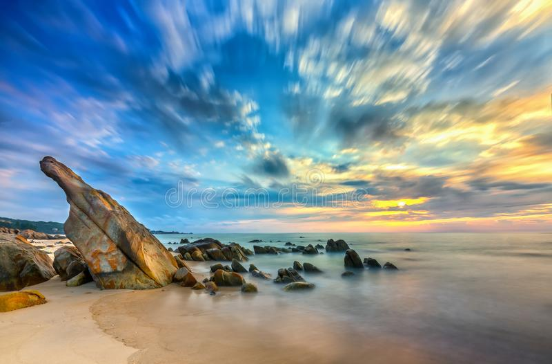 Volcanic rocks beach in sunrise with dramatic sky, below reefs royalty free stock photos