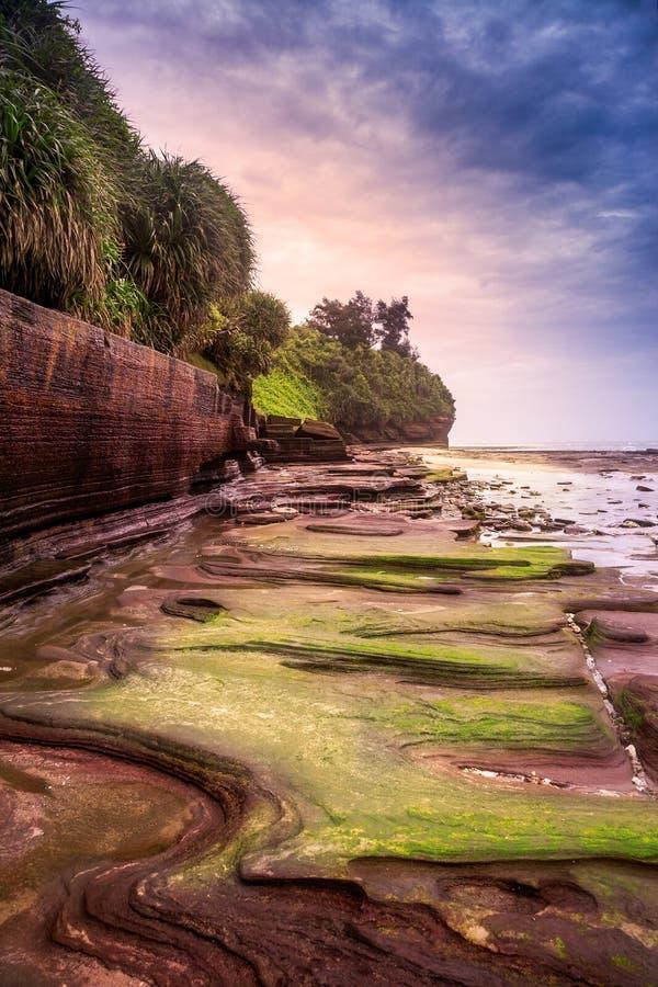Volcanic rocks in the Colorful beach, Weizhou Island. Colorful beach, sunset landscape in Weizhou Island Volcano National Geological Park of China,Beihai,Guangxi