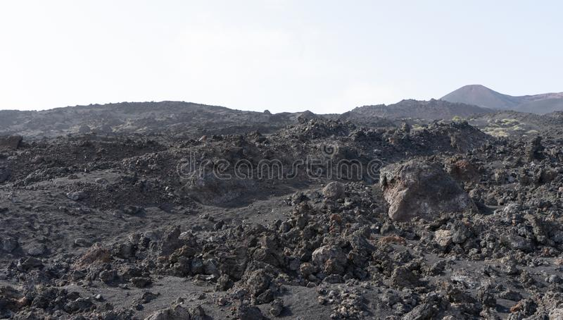 Volcanic rocky land with black arid desert in Canary Island. Lava soil and basalt on a national park royalty free stock images