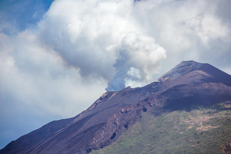 Volcanic smoke coming out of one of the craters of Mt Stromboli royalty free stock photos