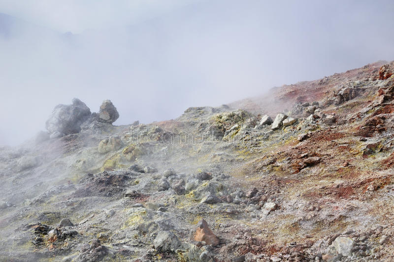 Volcanic steam of sulfur stock photos