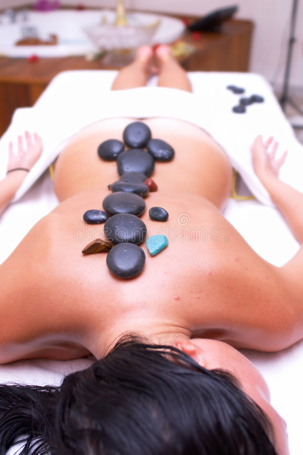 Volcanic stone massage stock photo