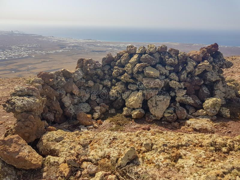 Volcanic stone walls. Built to protect from the strong wind on the island of Lanzarote, Canary Islands. Spain. Nature, female, walking, view, travel, volcano royalty free stock photo