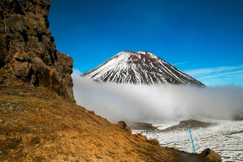 Devil`s Staircase steep climbing to South Crater and view of Mt Ngauruhoe, Mt Doom, Tongariro crossing New Zealand Great Walk royalty free stock photos