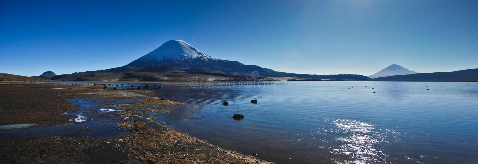 Volcano above a lake stock photo