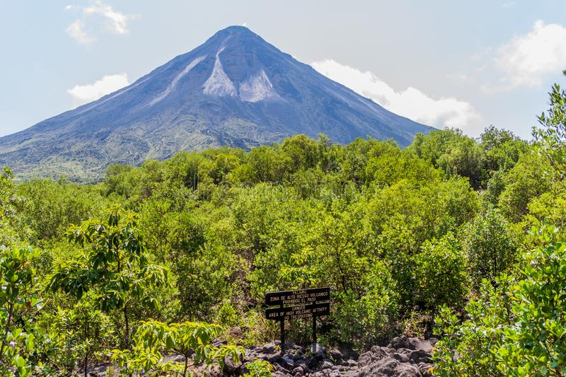 Volcano Arenal behind a lava field in National Park Arenal, Costa Ri. Ca stock images