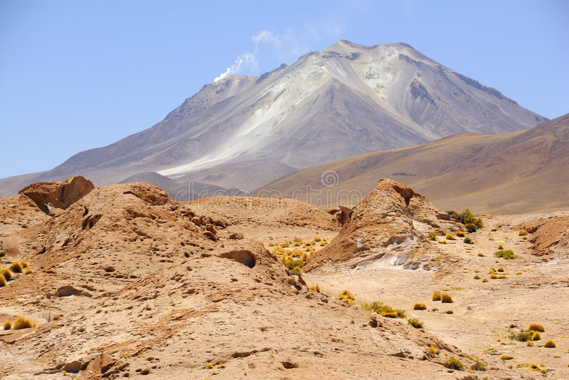 Volcano, border Chile - Bolivia. The Altiplano (Spanish for high plain), in central South America, where the Andes are at their widest, is the most extensive stock photography