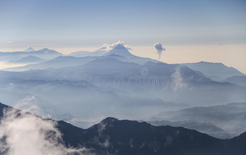 Volcano chain of Guatemala from the summit of the Tajumulco Volcano, San Marcos, Guatemala. The Central American Volcanic Arc often abbreviated to CAVA is a stock photos