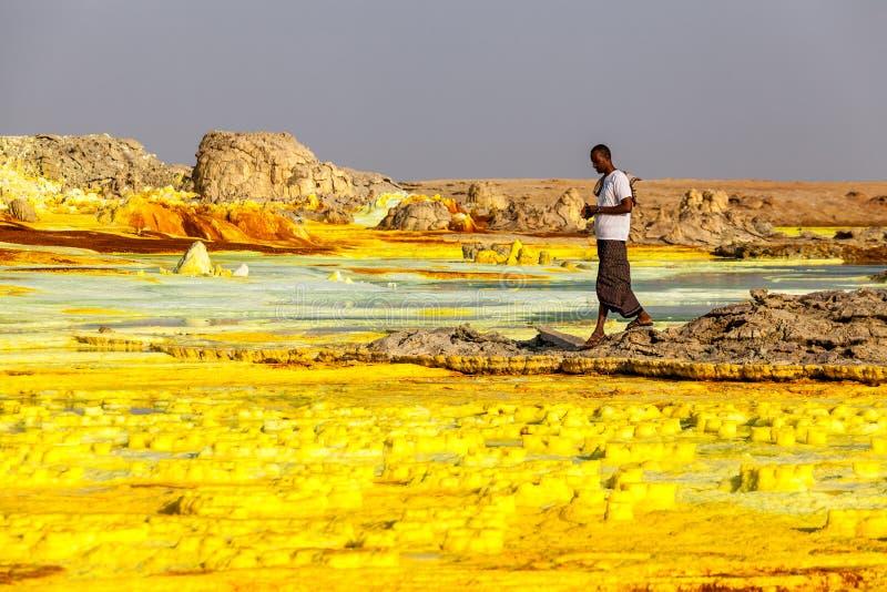 Volcano Dallol, Ethiopia. Afar region, Ethiopia 24.11.2016 Colourful volcano Dallol in Danakil dessert, Ethiopia. People walking across mineral soil formations