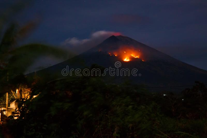 Eruption with lave of volcano Agung in Bali, Indonesia royalty free stock image