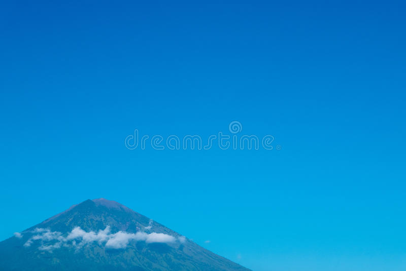 Volcano Gunung Agung with clear blue sky from Amed in Bali, Indonesia royalty free stock image