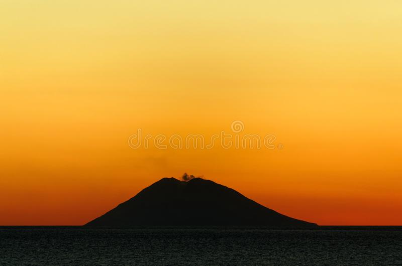 Volcano island Stromboli at sunset, Italy. Volcano Stromboli at sunset. Stromboli is an active volcano island in Italy. This photo was shot from the city Tropea royalty free stock photography
