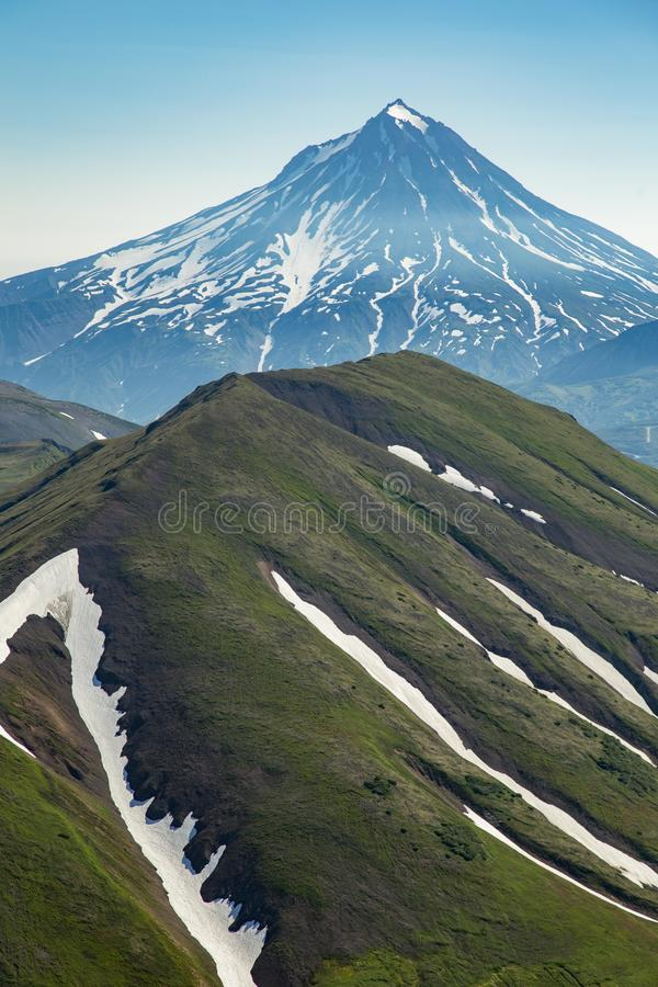 Aerial flight above volcanos of Kamchatka the land of volcanos and green valleys royalty free stock photography