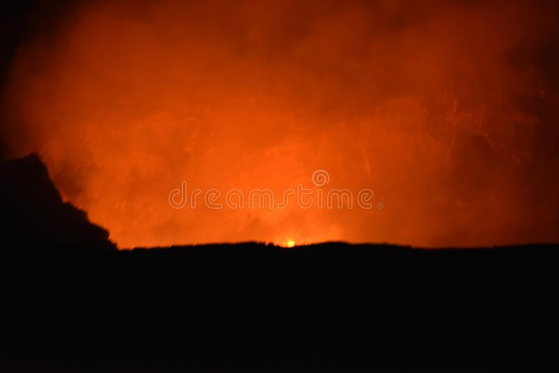 Volcano at Night with Lava and smoke royalty free stock photos