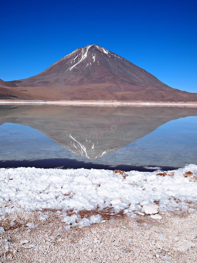 Volcano reflection in Laguna Verde royalty free stock photography