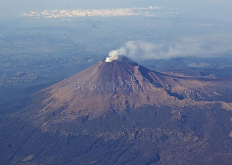 Volcano with smoke coming out stock image