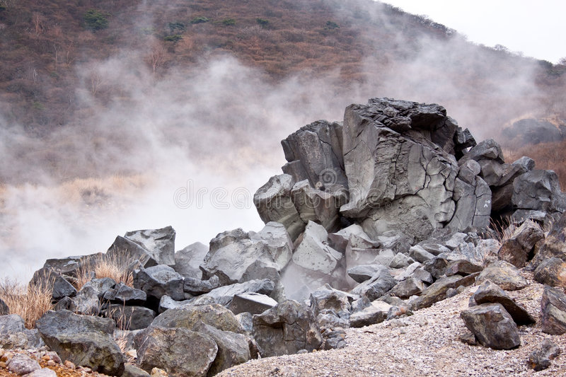 Volcano sulfur steam pit and rock stock image