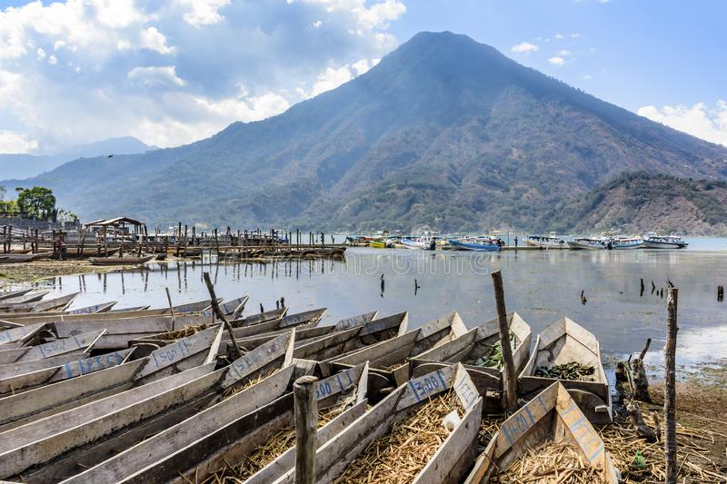 Volcano & traditional boats by lakeside, Santiago Atitlan, Lake Atitlan, Guatemala royalty free stock images
