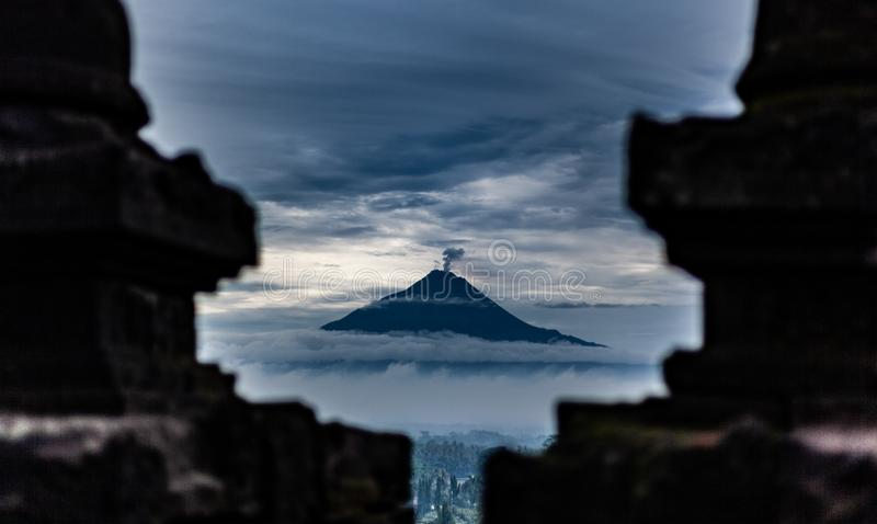 Volcano view from a temple royalty free stock photo