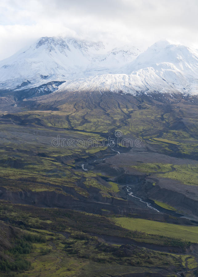 Volcanon mount Saint Helens. Volcano mount Saint Helens decapitated top with glacier and surrounding bogland with trenches and in clouds royalty free stock images