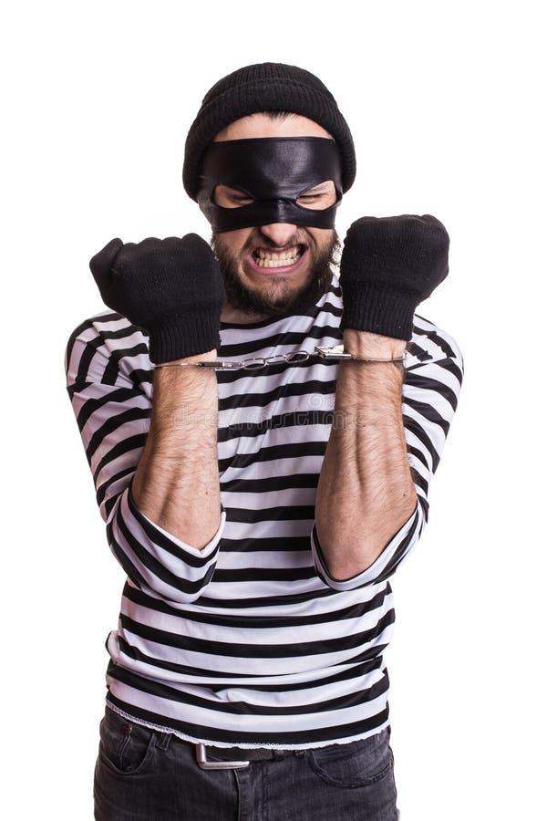 Voleur fâché avec des menottes photos libres de droits