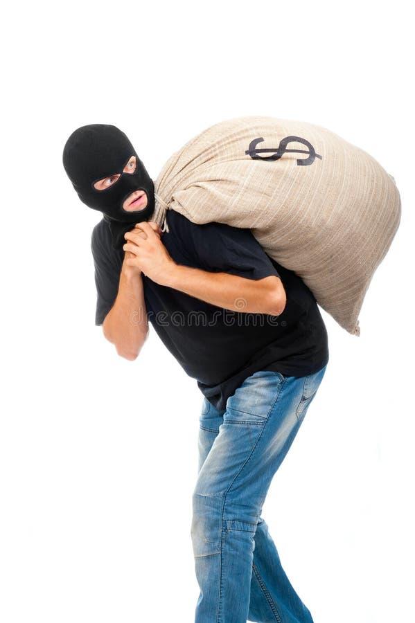 Voleur heureux avec le sac plein des dollars images libres de droits
