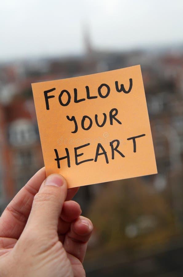 Volg uw hart stock foto's