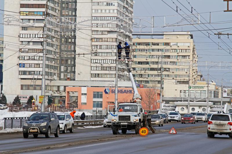 Workers on the crane install and decorate the Astrakhan bridge with led light in Volgograd. Volgograd, Russia - 28 December, 2018: Workers on the crane install stock image