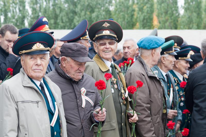 Old military personnel of the man with medals. VOLGOGRAD, RUSSIA - October 15, 2017: Group of old military pensioners in a military uniform, awards and medals stock images