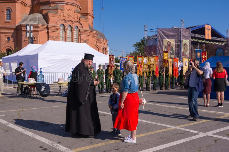 Volgograd. Russia-September 12, 2019. The priest blesses a woman with a child at the Divine Liturgy, dedicated to the memory of royalty free stock image