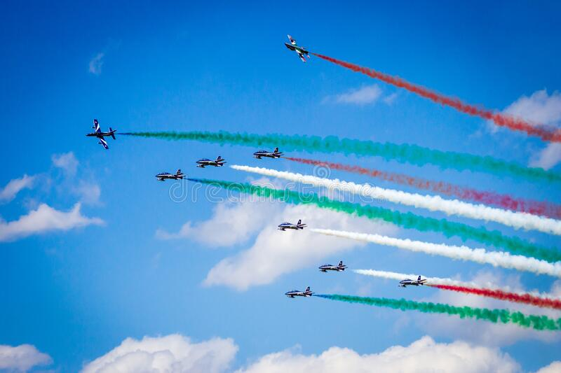 VOLKEL, THE NETHERLANDS - JUN 15, 2013: The Italian aerobatic demonstration team Frecce Tricolori performing with their MB339 jet. Aircraft at the Dutch Air stock photography
