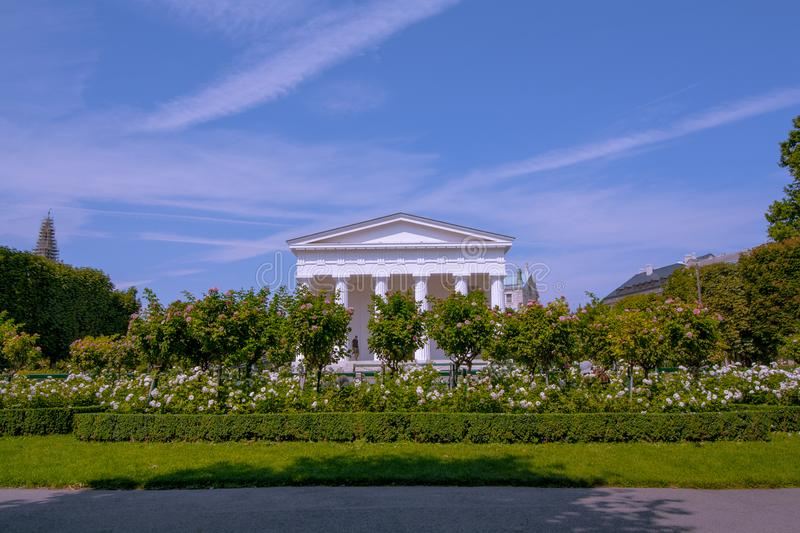 Volksgarten Public Park in Vienna, view on Theseus temple. Column Hall in the garden with beautiful colorful landscape royalty free stock photo