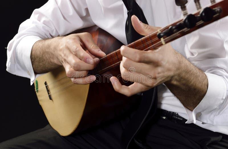 Volksinstrument mit drei doppelten Schnüren lizenzfreies stockfoto